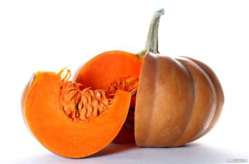 pumpkin on white background with piece cut